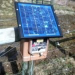 Solar fence charger used to electrify fence.