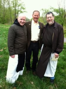 Father James Orthmann, left and Father Robert Barnes of the Holy Cross Abbey join me on the newly acquired property.