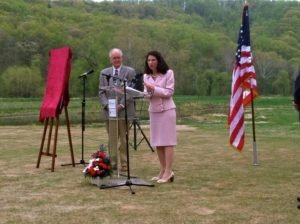 Dr. Tracy Fitzsimmons, President of Shenandoah University addresses the crowd at the ceremony.  James Lighthizer, president of the Civil War Trust is to her left.