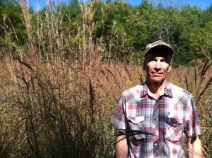 Jim Pile in native meadow at Cobble Hill Farm.