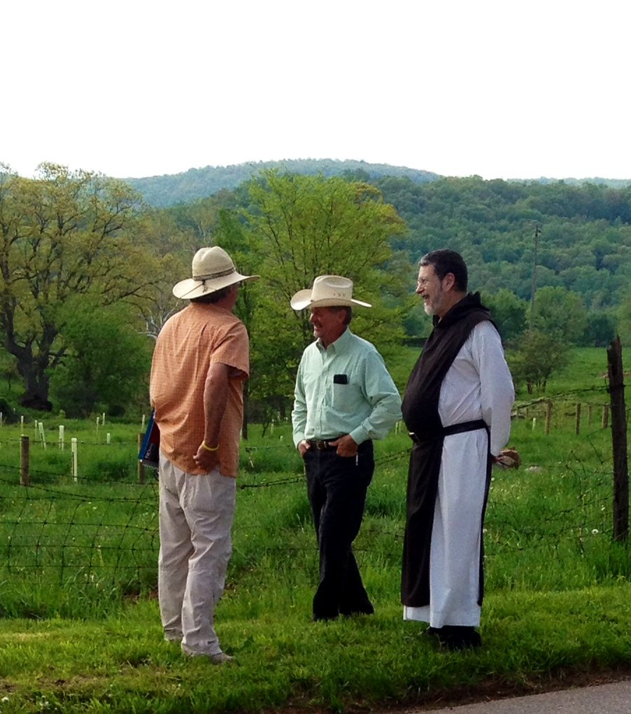 George Patterson, left and Father Robert, right discussing the stream fencing project with CBF contractor, Bobby Whitescarver